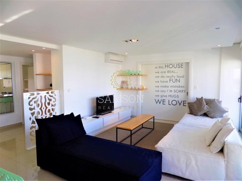 apartamento en exclusivo edificio, a metros de mar, playa brava, punta del este- ref: 92
