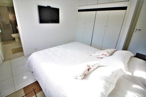 apartamento residencial à venda - praia das pitangueiras - 2 vagas de garagem - guarujá. - ap4057