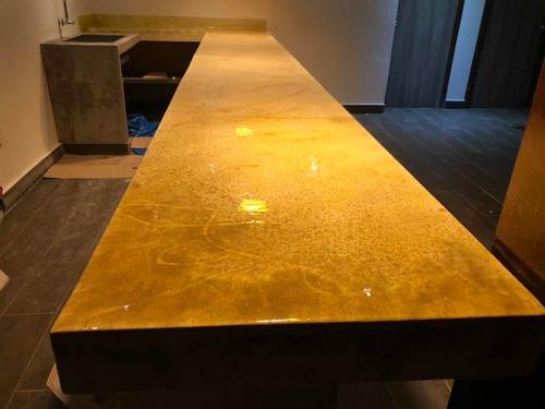 aplicación de porcelanato líquido en tableros, pisos y barra