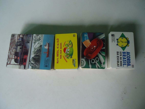 aproximadamente 300 cartões telefônicos diversos - no estado