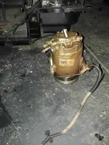 ar condicionado e direção hidráulica e elétrica