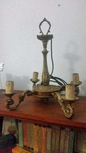 araña de bronce antigua
