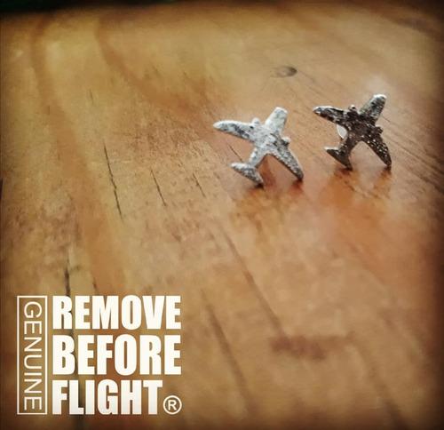 aretes avión plata ley remove before flight