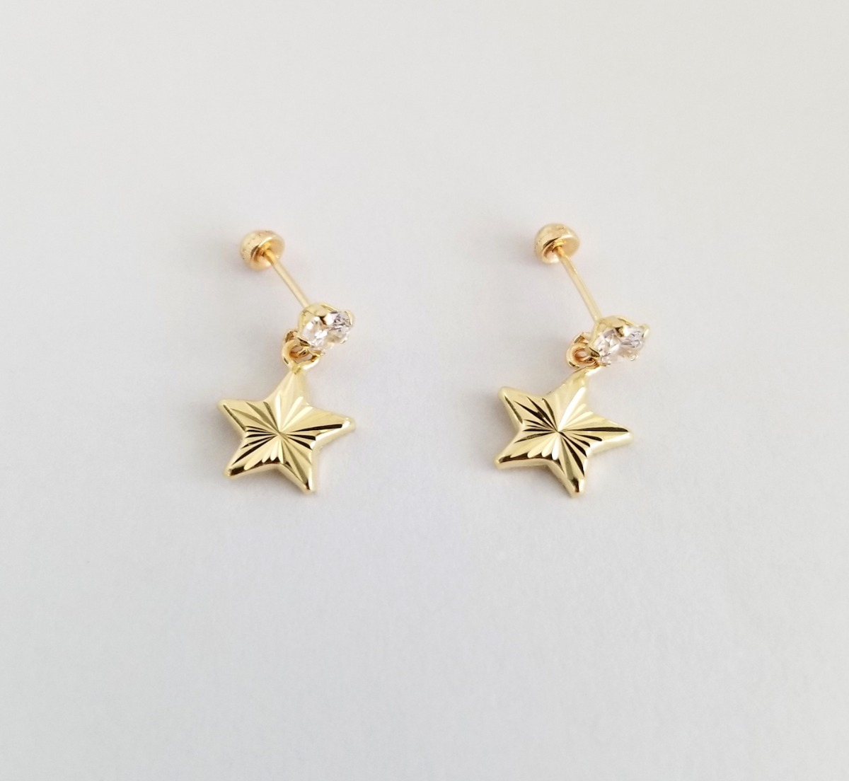 279166f4c42e aretes broquel estrella colgante para mujer oro sólido 10k. Cargando zoom.
