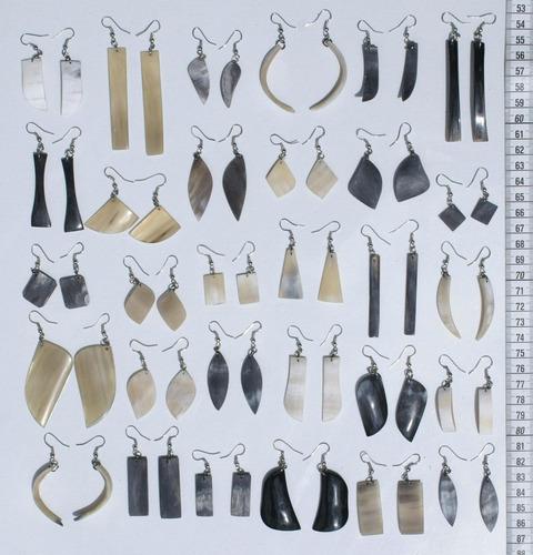 aretes de cacho tallados a mano en lesoto, bisuteria africa