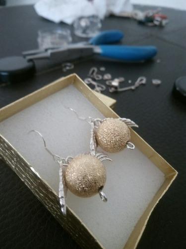 aretes de snich dorada en plata. 925 y chapa de oro