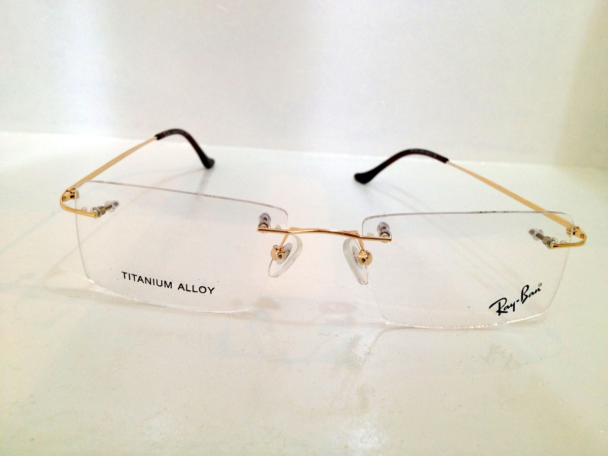 armação de óculos rayban titanium sem aro dourado c  marrom. Carregando  zoom. a273921a7f
