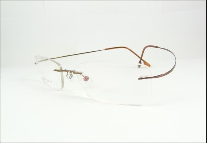 d8334a85570a7 Armação Marrom Feita De Titanium Óculos De Grau Sem Aro A576 - R  69 ...