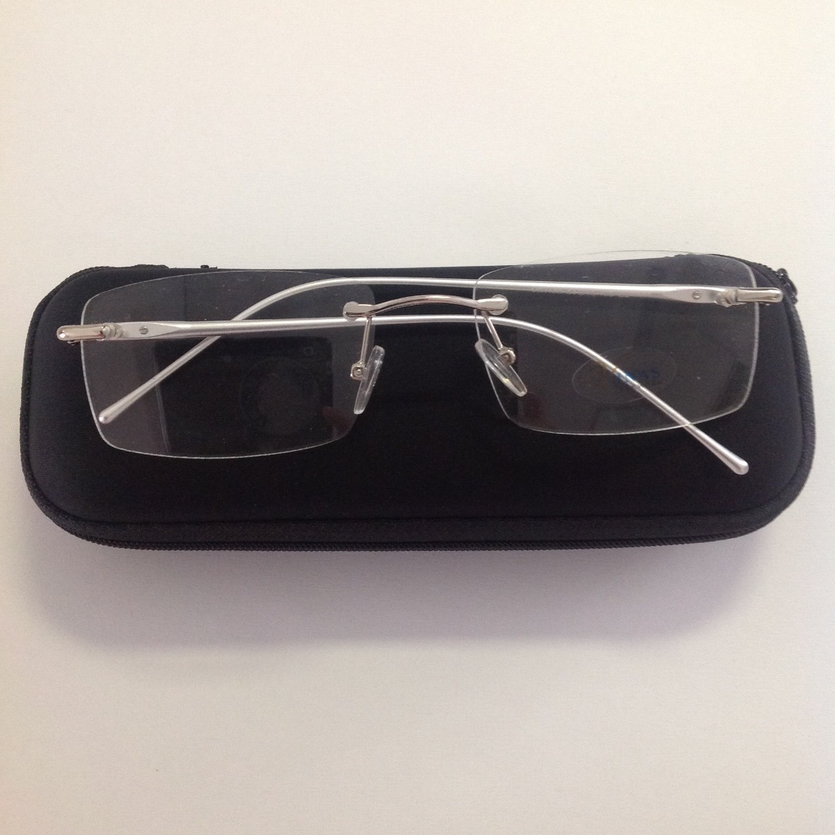08baddf73dab8 armação masculino óculos parafusado flutuante p grau prata. Carregando zoom.
