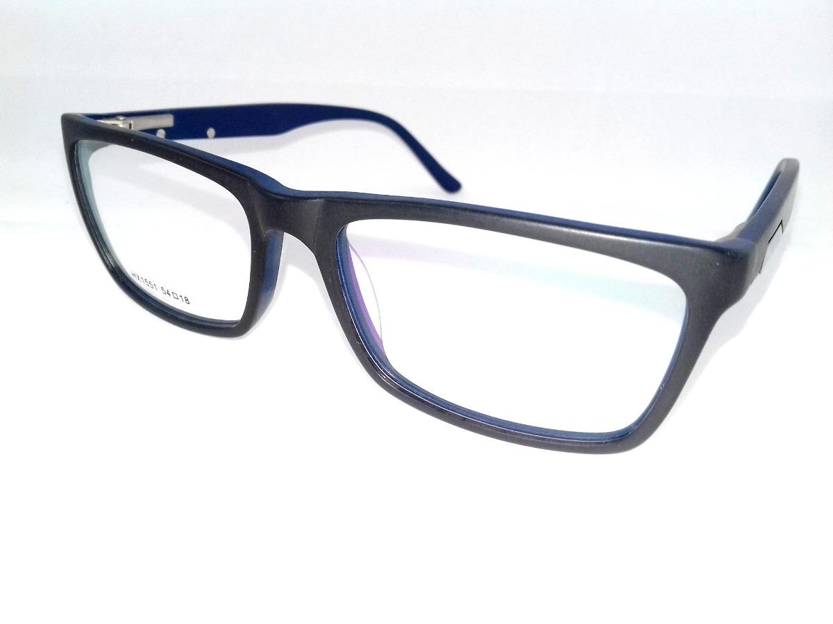 0a7cf0e84c574 armação óculos de grau masculino preto fosco com fundo azul. Carregando  zoom.