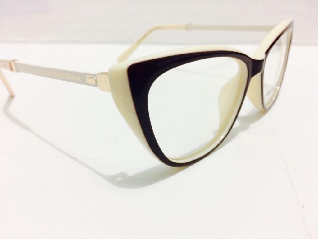 3ee4584240914 armação oculos dolce gabbana de grau preto com creme -dg101. Carregando  zoom.