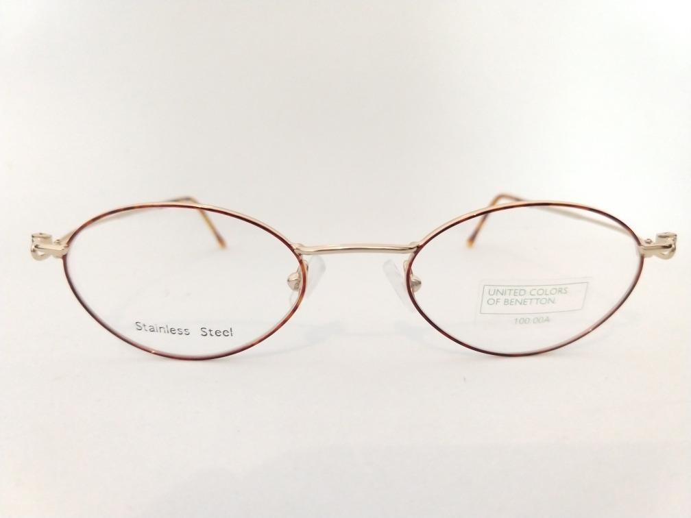 6ad2f5fed3fc6 armação óculos grau oval pequeno dourada benetton leve. Carregando zoom.