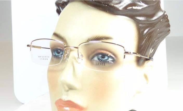 Armação Oculos Grau Titanium Dourada Bifocal Meio Aro A796 - R  69 ... 470b945d9f