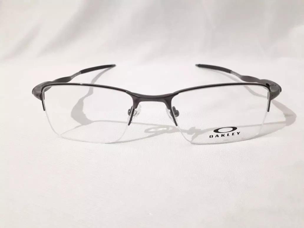 3403d7478cc69 armação óculos oakley p grau lupa descanso grafite. Carregando zoom.
