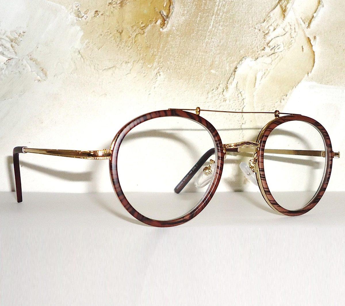 2c40c49ad2ca1 armação para óculos de grau dourado com detalhe nos aros. Carregando zoom.