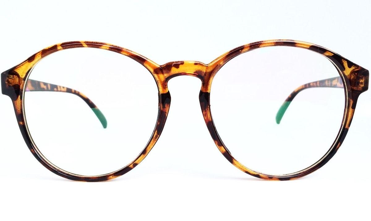Armação Para Óculos De Grau Redonda Vintage - Leopardo - R  50,56 em ... 32549fbaca