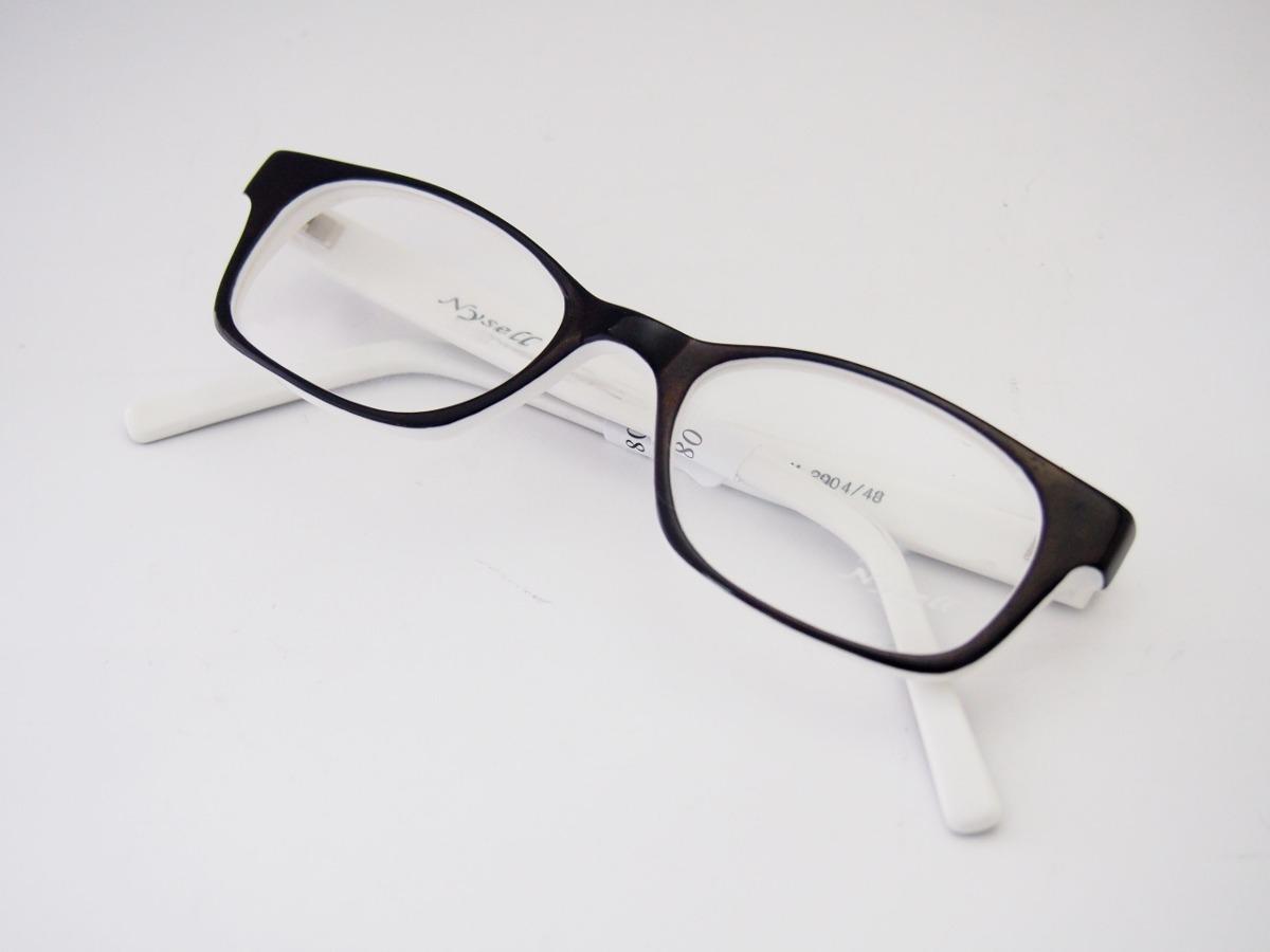 5a2e66b4120b2 armação para óculos nysell acetato preto e branco m2904. Carregando zoom.