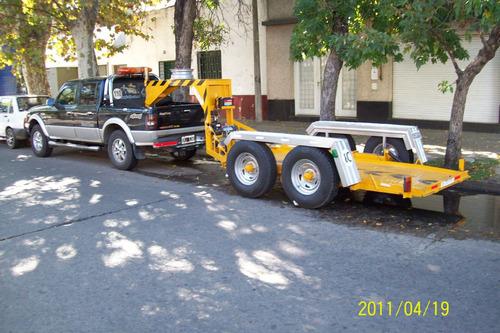autos auxilio trailer