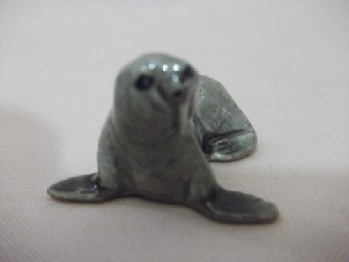 b. antigo - leão  marinho miniatura em porcelana alemã