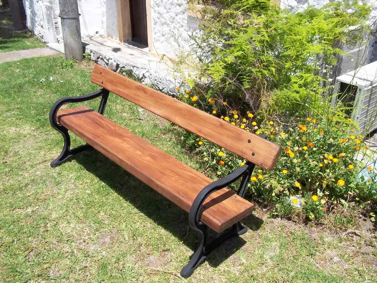 Banco de hierro fundido y madera para jardin for Madera para jardin