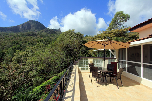 beautiful mountain home with breathtaking views and tropical