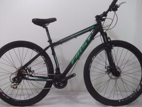 bicicleta  aro 29 first preta/verde 24v com kit cxr-8