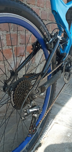 bicicleta doble suspensión celeste