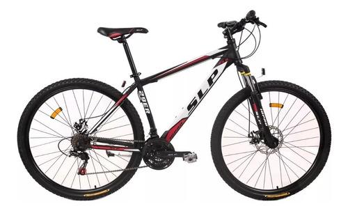 bicicleta slp 10 pro r29 shimano 21v f/ disco suspen + casco