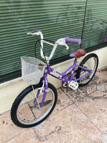 bicicleta usada benotto morada para niña con canastita