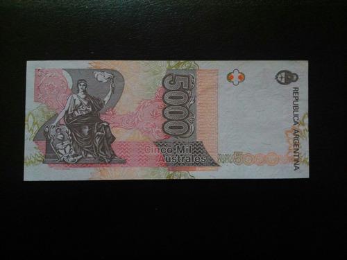 billete australes 5000. firmas torcidas. n. serie inclinado