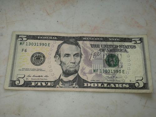 billete de 5  dolares estados unidos con fecha de nacimiento