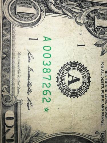 billete de un dolar con estrella año 2013