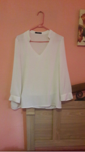 blusa blanca manga larga mango. santa tecla