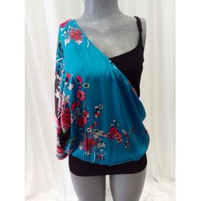 c91ddc89b9e09 Blusa Un Hombro Azul Con Flores Bebe. La Segunda Bazar