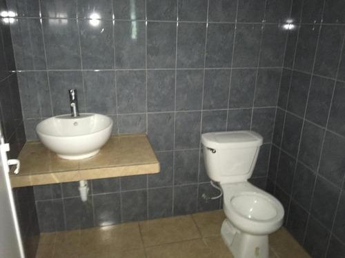 bodega industrial con anden de descarga propio, 2 baños, oficinas, con camaras y acceso por el periferico tixcacal-poniente