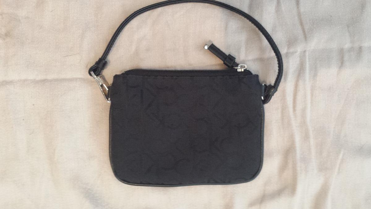0247686bc Bolsa Preta De Mao Ck Calvin Klein Detalhes Em Couro Logo - R$ 219 ...