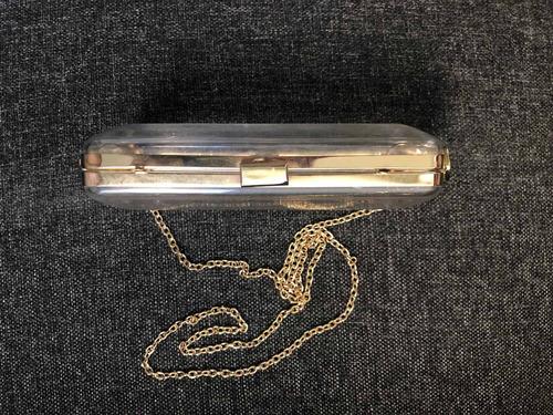 bolsa clutch transparente con cadena de h&m