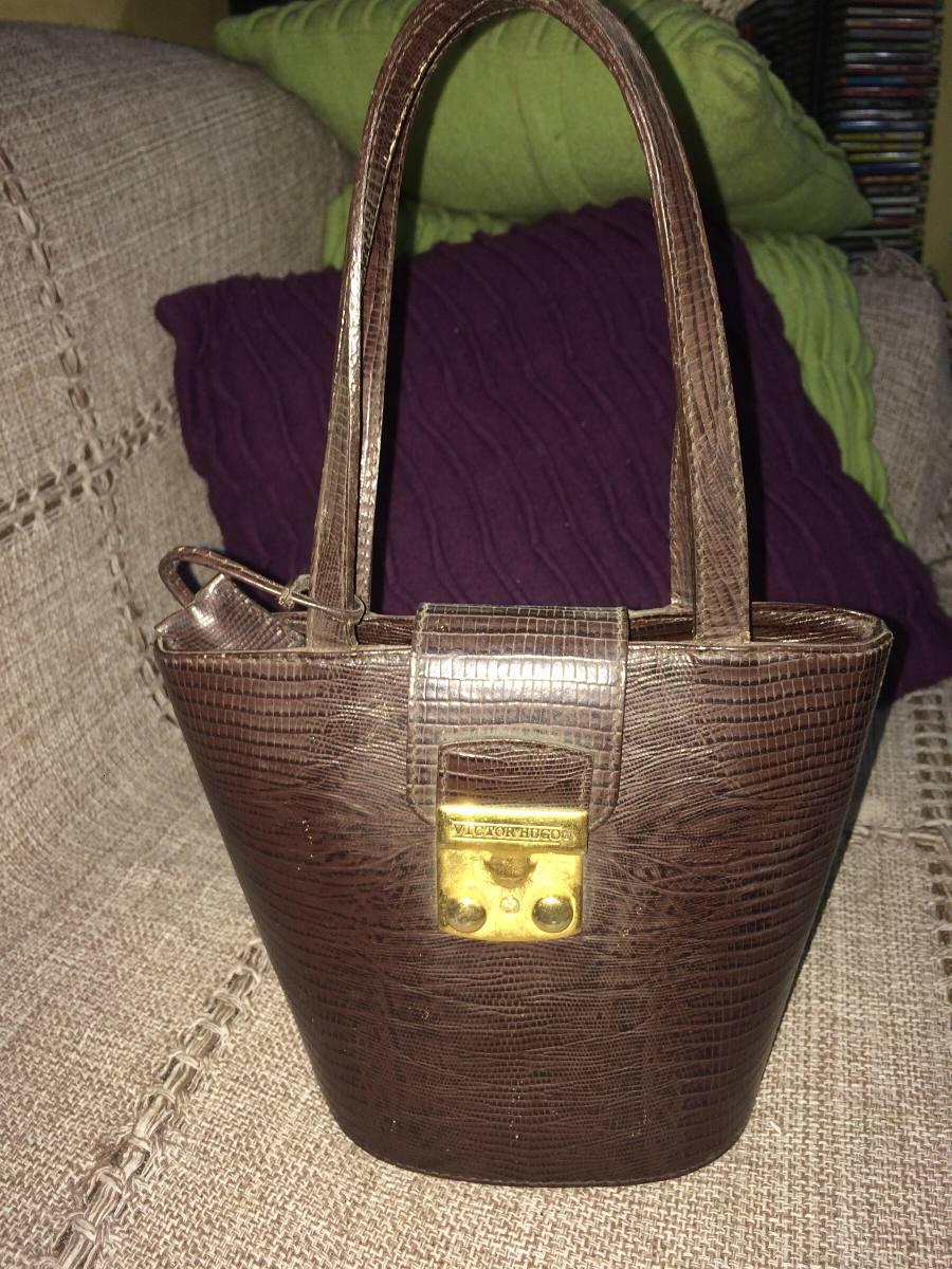 d07d48c0143c1 Bolsa De Mão Em Couro Marca Victor Hugo - R  100