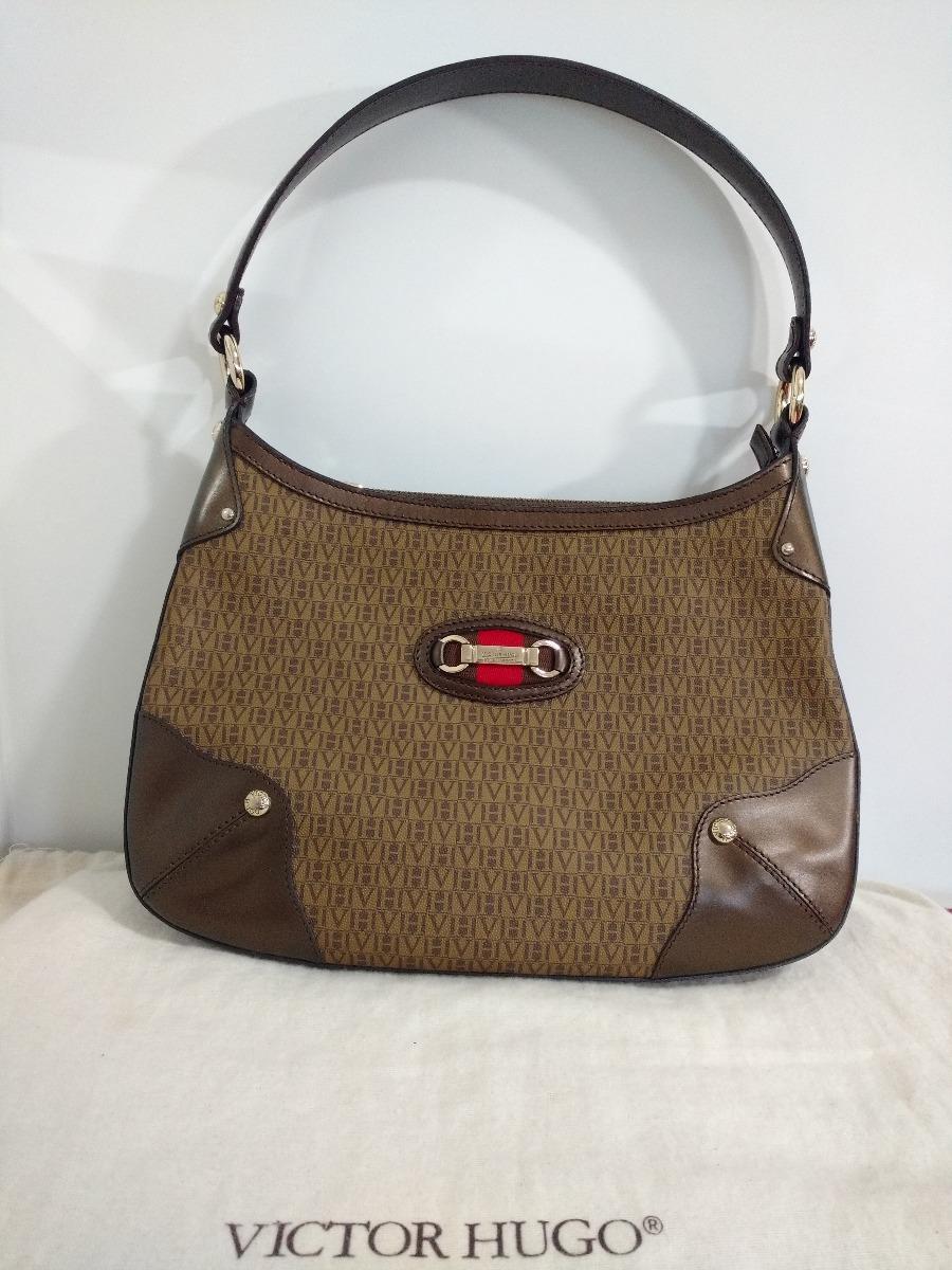 e50122747c61c bolsa de couro victor hugo original monograma - marrom cobre. Carregando  zoom.