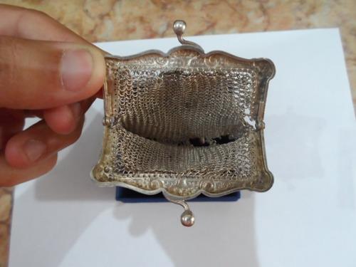 bolsa de prata com  contraste