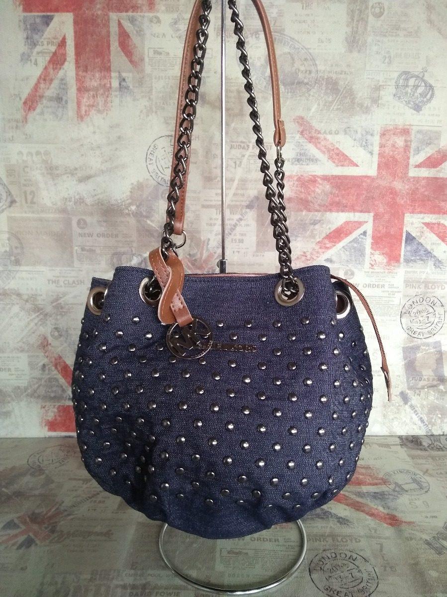 59a377e1a bolsa feminina mk saco jeans com spikes e alça em corrente. Carregando zoom.