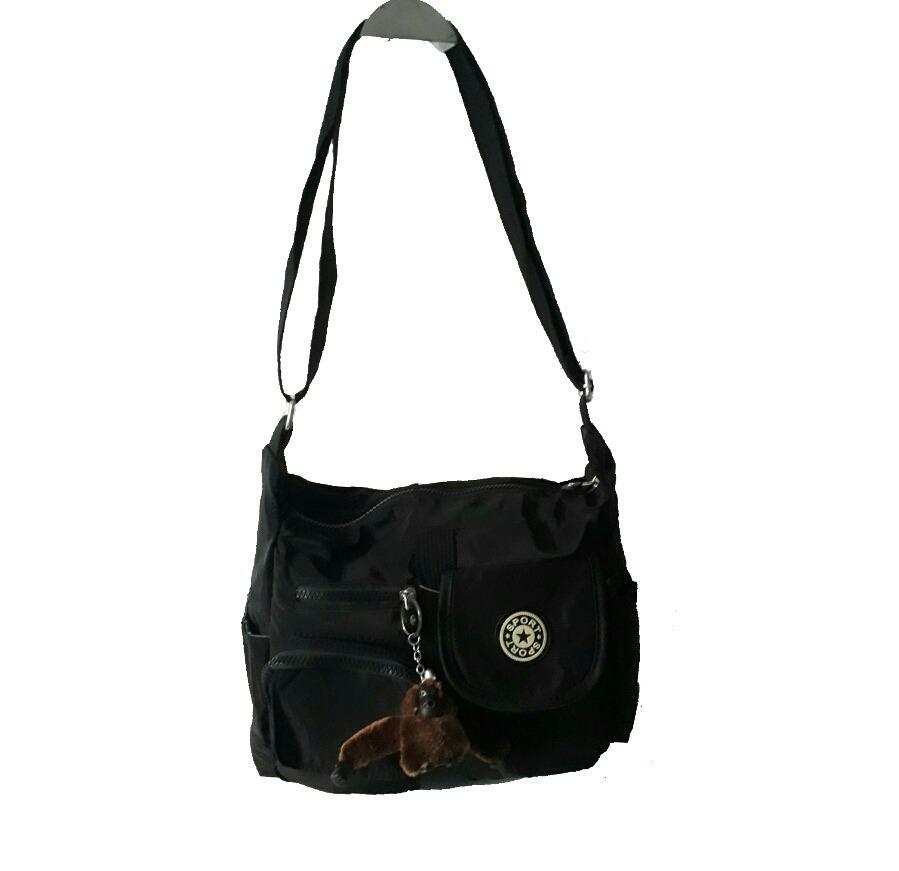 8d7998ce6 bolsa feminina nylon tiracolo escolar com chaveiro. Carregando zoom.
