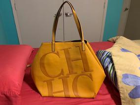 2f5c90b9a7 Bolsa Imitación Carolina Herrera Mostaza · $ 760. 18x $ 55