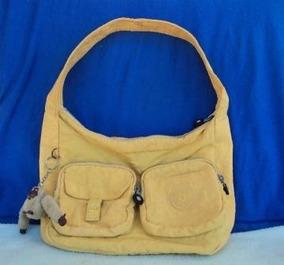c110aca66 Mochila Kipling Amarela - Calçados, Roupas e Bolsas no Mercado Livre Brasil