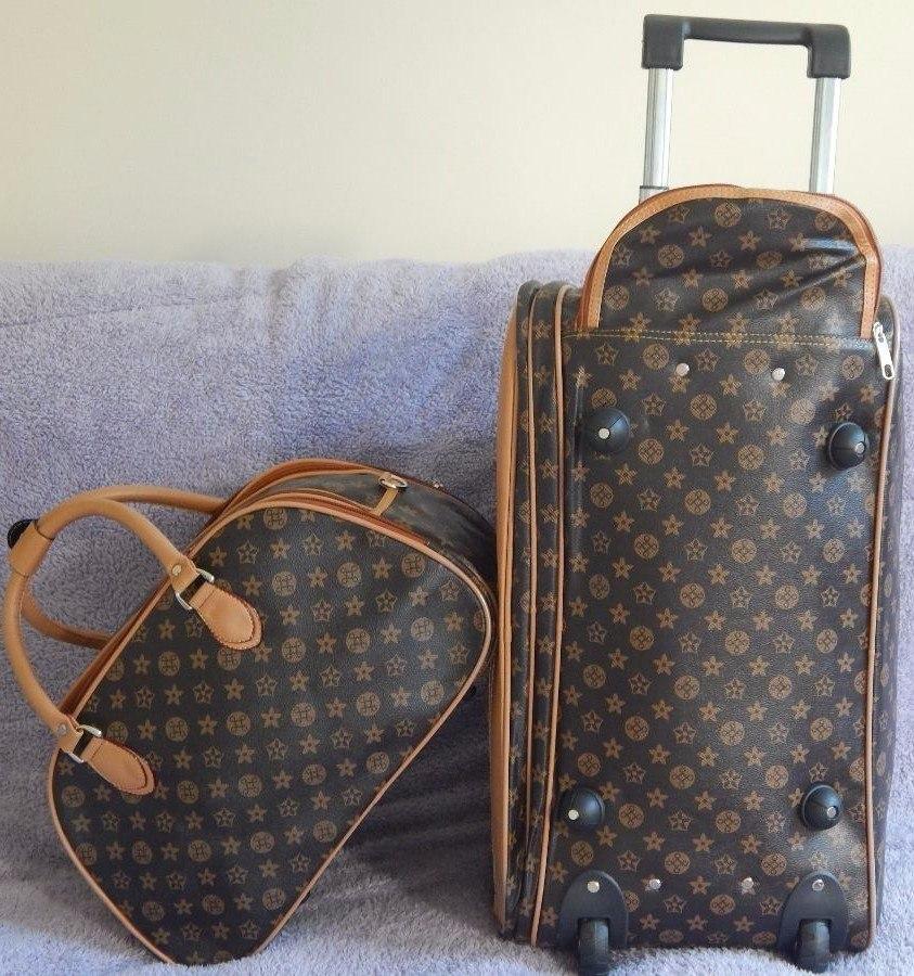 bolsa mala de viagem feminina de oncinha com rodinha r 239 00 em mercado livre. Black Bedroom Furniture Sets. Home Design Ideas