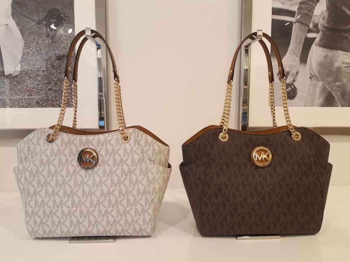 f4d2e8fe8 bolsa michael kors jet set chain original monograma brown. Carregando zoom.