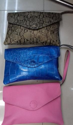 bolsas carteras tipo sobre 100 % piel.