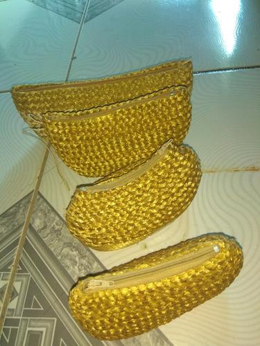 bolsas de mão em capim dourado
