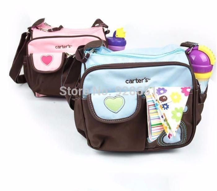 bolso maternal carter´s super practico vs bolsillos urquiza