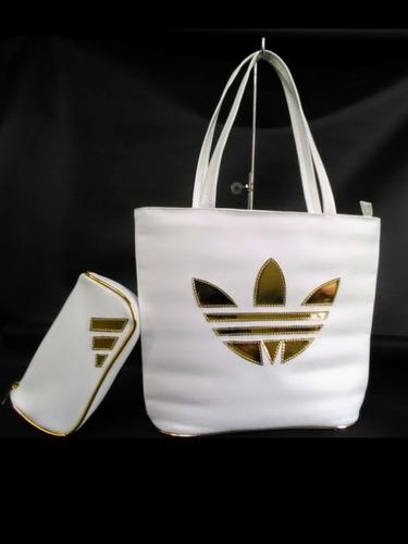 bolsos carteras de dama adidas, con portacosmeticos.